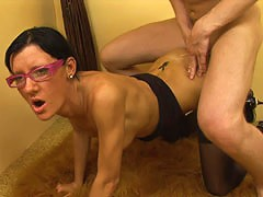 Serious bitch in black stockings enjoys anal sex